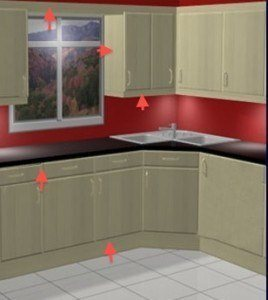 the arrows point to elements of a kitchen that would not match new doors