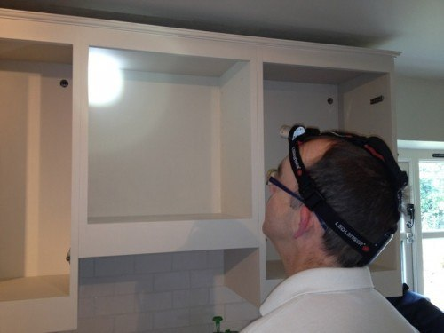 Mark Nash checking the finish paint work in a recent kitchen