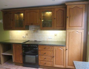 The original, rather orange oak kitchen