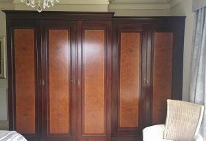 The original dark wood wardrobes