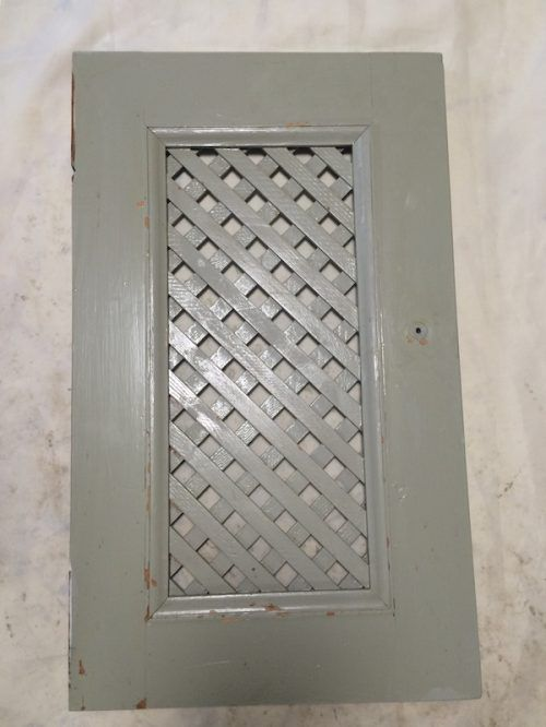 painted lattice door Fussy dated moulding and lattice work