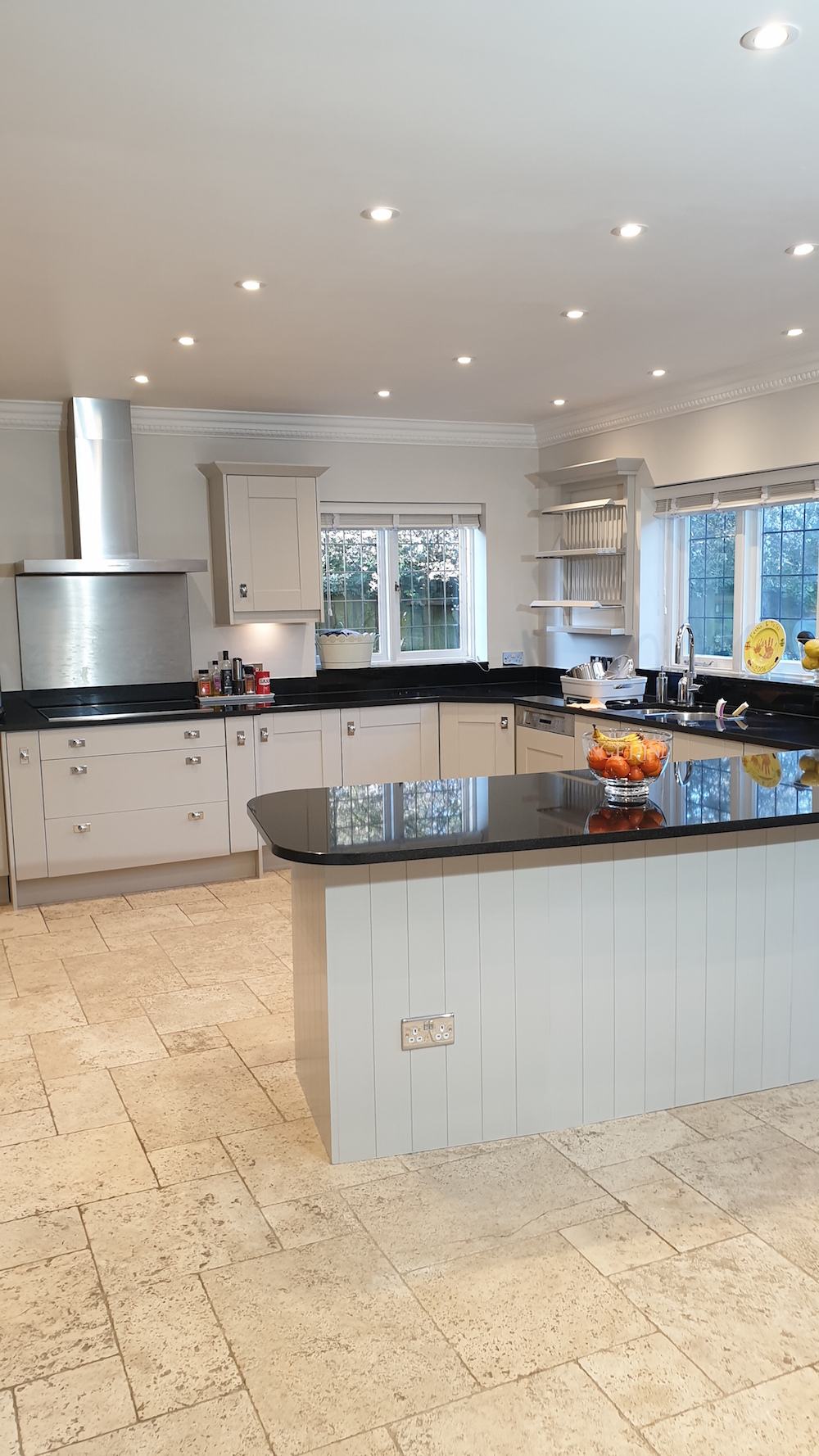 Well designed oak kitchen repainted in contemporary semi matt paint. Kitchen painted in Radlett
