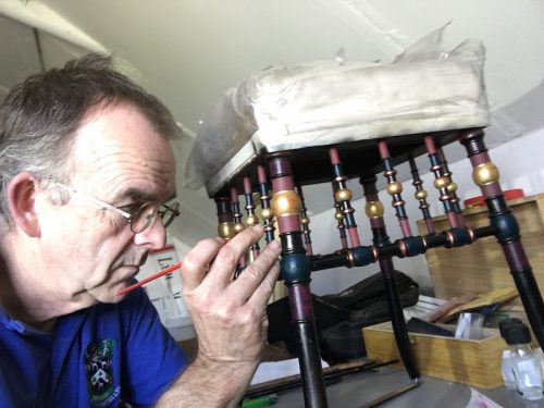 Mark Nash restoring an antique German stool