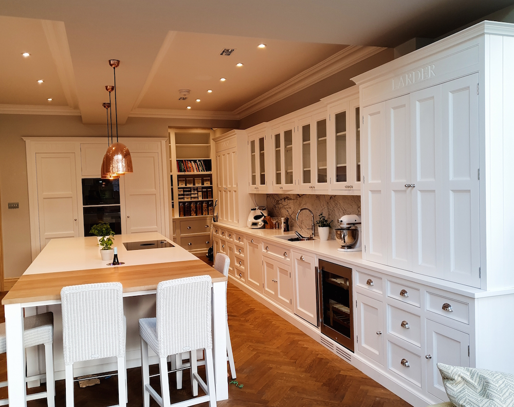 Big white wooden Christchurch hand painted kitchen in Surrey