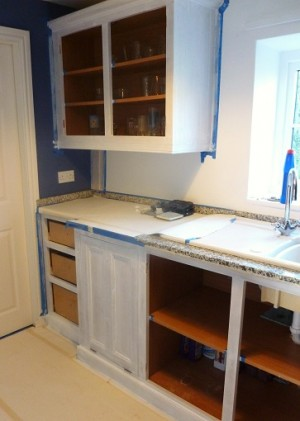 The utility room without the doors and drawers which i painted in my workshop