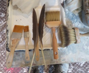 Some of the brushes and feathers I used to acheive the effect